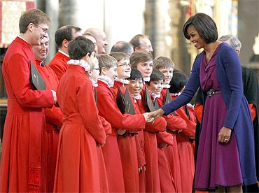 Obama greets members of the choir at Westminster Abbey