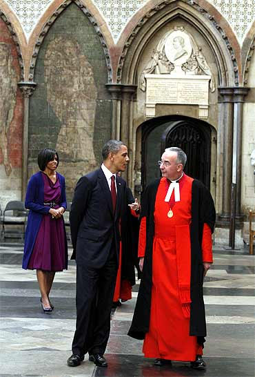 The Obamas are escorted around Westminster Abbey by the Dean of Westminster Dr John Hall