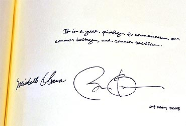 A message from Obama and first lady Michelle Obama, apparently signed by the President with the wrong date in the distinguished visitors' book during a tour of Westminster Abbey
