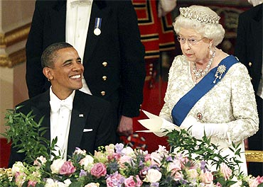 Obama enjoys a light moment with the Queen