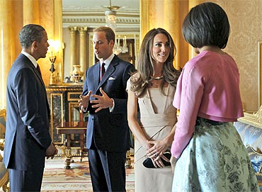 Obama and First Lady Michelle Obama talk to Britain's Prince William and Catherine, Duchess of Cambridge