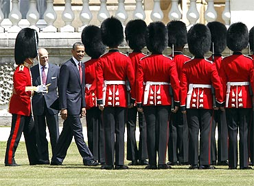 Obama reviews an honor guard with Prince Phillip, Duke of Edinburgh, during an official arrival ceremony at Buckingham