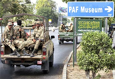 Soldiers depart from the Mehran naval aviation base after troops ended operations against militants in Karachi