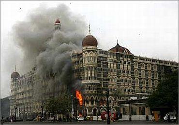 A burning Taj Mahal Hotel in Mumbai during 26/11 terror attacks