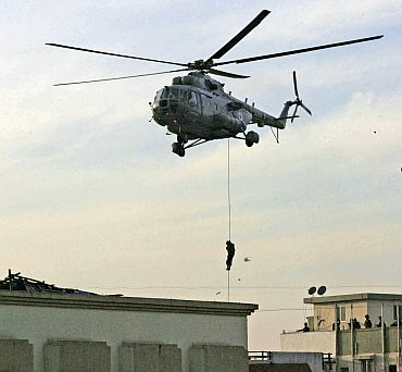 NSG commando rappels from helicopter near Nariman House in Mumbai
