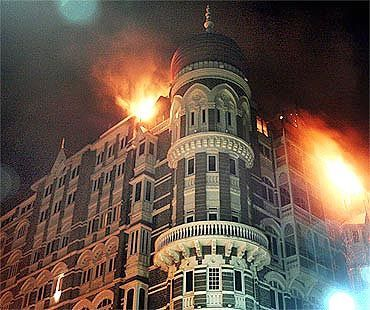 A burning Taj Mahal Hotel in Mumbai during the 26/11 terror strikes