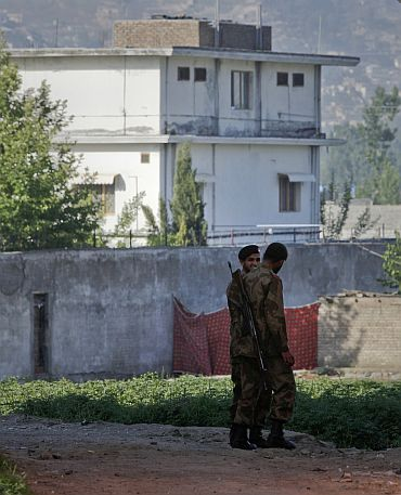 Soldiers keep guard around a compound within which Al Qaeda leader Osama bin Laden was killed in Abbottabad, Pakistan