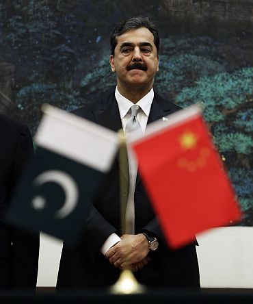 Pakistan's Prime Minister Yusuf Raza Gilani looks on as he attends a signing ceremony at the Great Hall of the People in Beijing