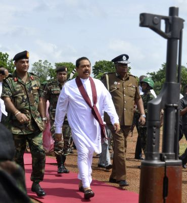 Sri Lankan President Mahinda Rajapaksa is escorted by the military to a cabinet meeting