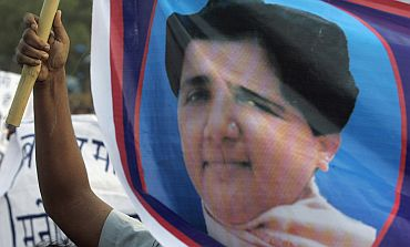 A BSP supporter holds a poster of Mayawati,