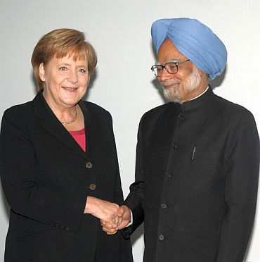 File photo of Merkel with Prime Minister Manmohan Singh