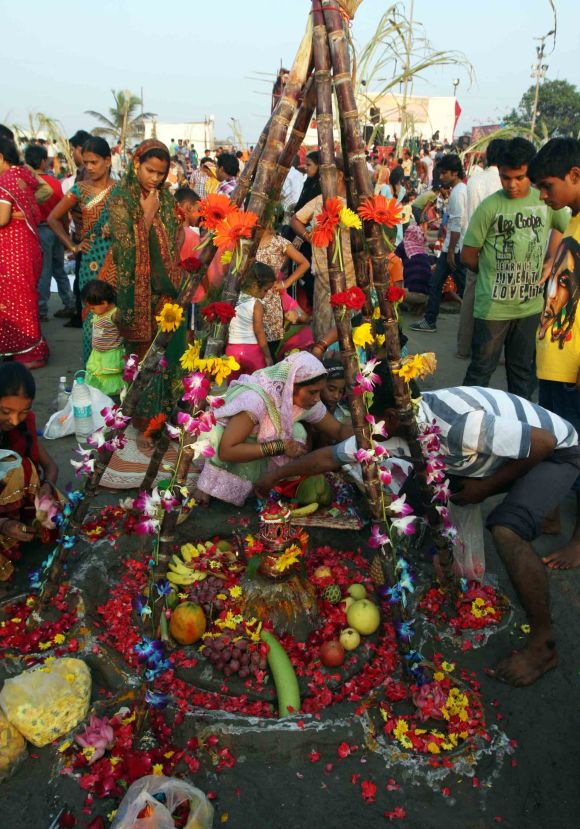 Devotees at Juhu beach in Mumbai offer prayers to the Sun God