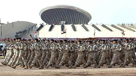 Soldiers take part in a parade marking the Iraqi Army's 90th anniversary in Baghdad.