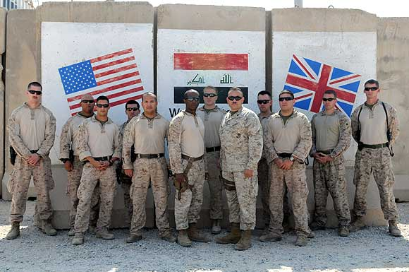 A team of 13 US Marine Corps trainers assigned to the Iraqi Marine Training Team gather for a photo