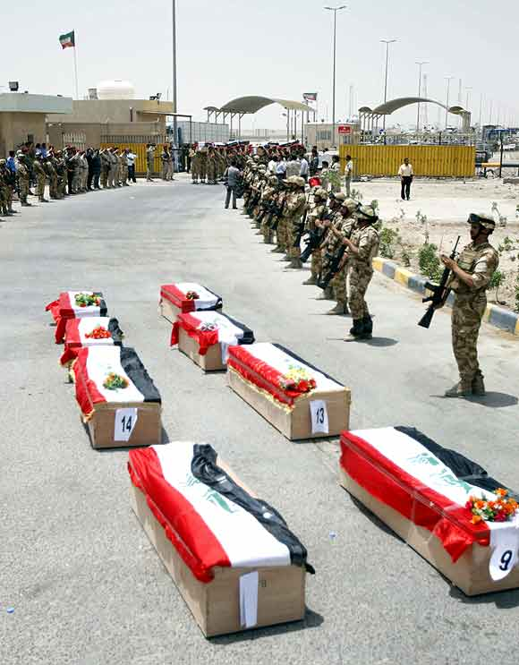 Coffins bearing the remains of Iraqi soldiers who were killed during the 1991 Gulf War