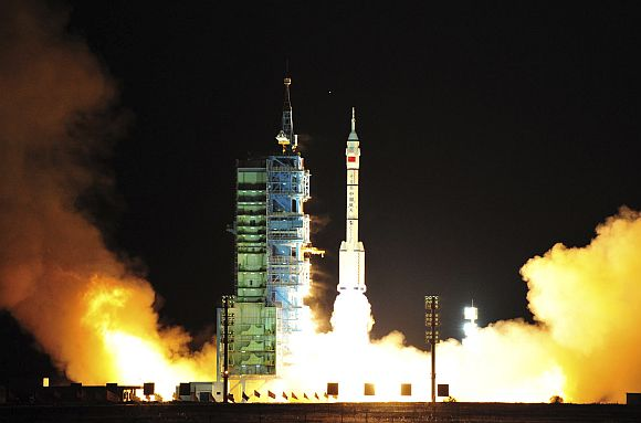 A Long March CZ-2F rocket carrying the unmanned spacecraft Shenzhou-8 blasts off from the launch pad at the Jiuquan Satellite Launch Center in China