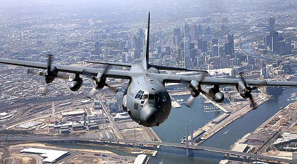 A Royal Australian Airforce C-130 Hercules flies over Melbourne