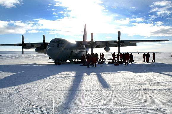 A Hercules transport plane stands on a frozen airstrip in Antarctica