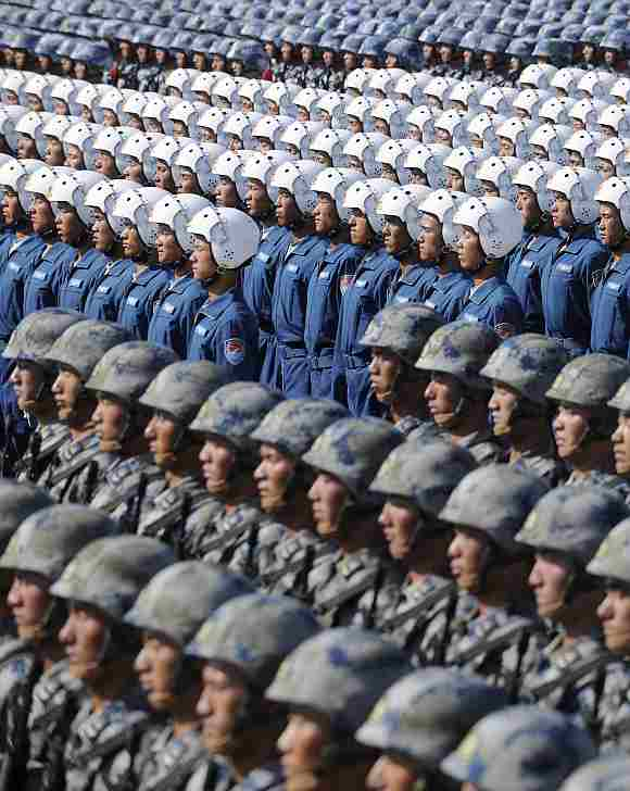 Soldiers from Chinese People's Liberation Army, Navy Marine Crops, Air Force Aviation and Airborne Corps (from top to bottom) stand at attention during a training session at the 60th National Day Parade Village on the outskirts of Beijing.