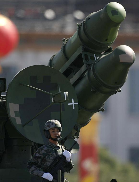 A PLA soldier is seen in front of a rocket launcher during a massive parade to mark the 60th anniversary of the founding of the People's Republic of China in Beijing