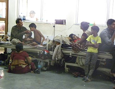 An overcrowded corridor outside the children's encephalitis ward in BRD Hospital, Gorakhpur