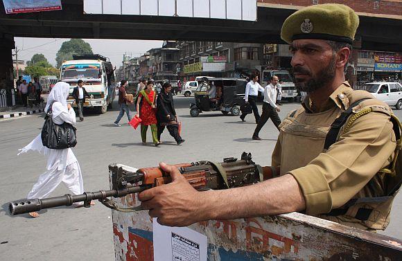 A paramilitary trooper keeps vigil at a security check post