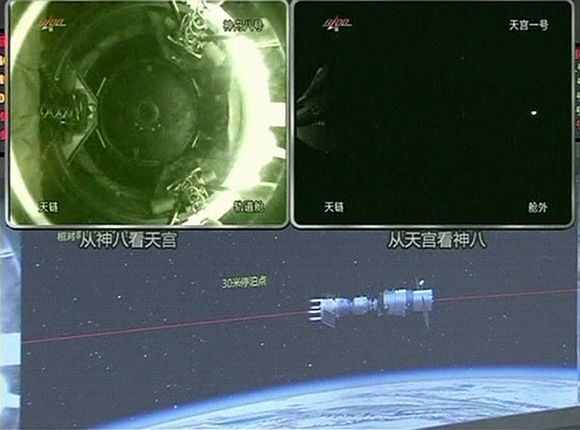 Tiangong (Heavenly Palace) 1 module (top L) as it docks with the Shenzhou 8 spacecraft