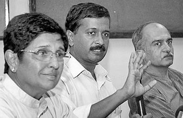 Team Anna members Kiran Bedi, Arvind Kejriwal, Prashant Bhushan