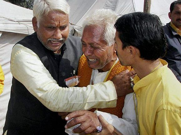 Relatives mourning the death of a family member at the stampede in Haridwar