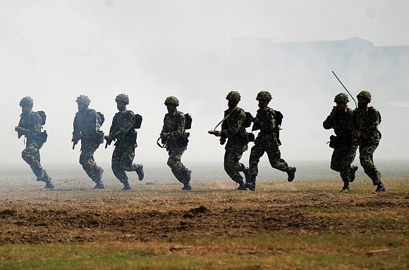Pakistani soldiers perform their attacking skill during a show to mark Defence Day in Lahore. Pakistan celebrates Defence Day on September 6 every year to mark the start of the 1965 war with India.
