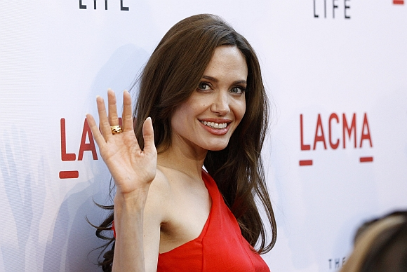 Actress Angelina Jolie waves at the premiere of The Tree of Life in Los Angeles