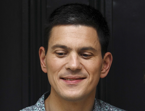 Labour politician David Miliband poses for a photograph outside his home in London