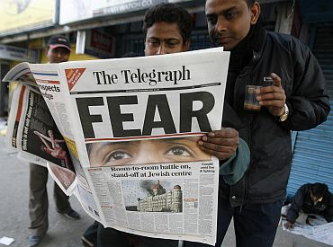 File image of people in Siliguri reading a newspaper carrying reports of the 26/11 attacks in Mumbai