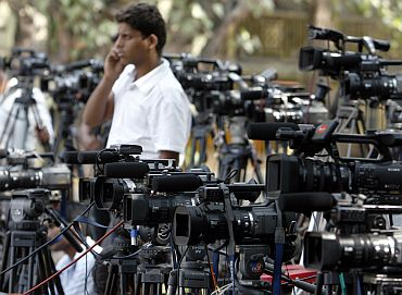 Video cameras of various news channels are placed outside Arthur Road jail in Mumbai