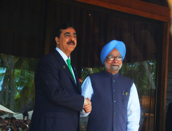 PM Singh meets his Pakistani counterpart Yousuf Raza Gilani during the SAARC summit in Maldives on Thursday