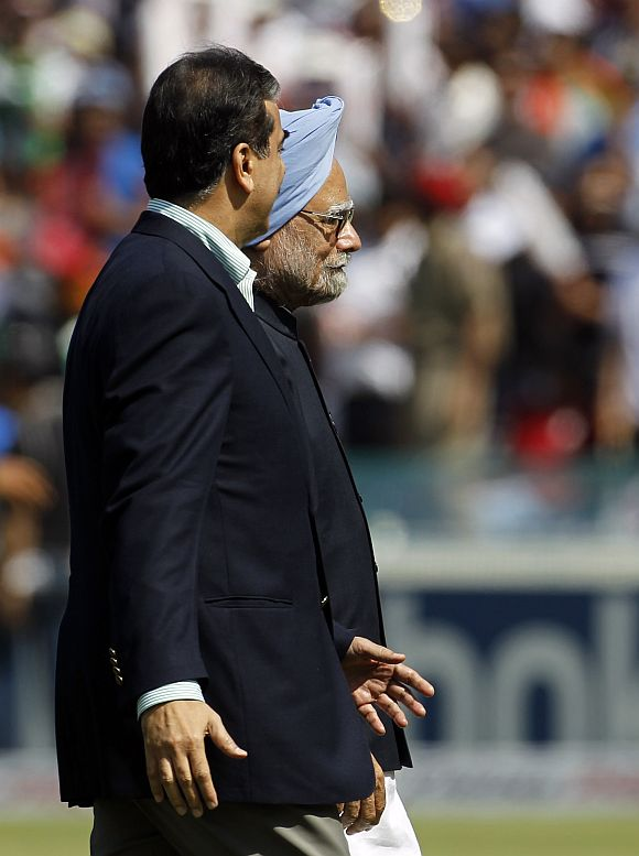 Dr Manmohan Singh and Pakistan's Prime Minister Yusuf Raza Gilani walk together ahead of the ICC Cricket World Cup semi-final match between their countries in Mohali in this picture taken on March 30, 2011.