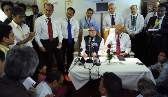PM Manmohan Singh addressing media persons on board his special aircraft