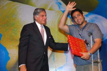 Ransley Santhumayor with Tata group head Ratan Tata during an event