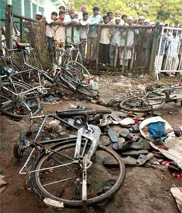 A file photo of damaged bicycles and torn footwear of bomb blast victims strewn at the blast site