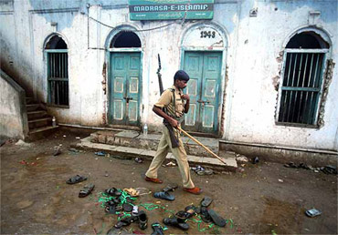 A file photo of a policeman at the blast site in Malegaon