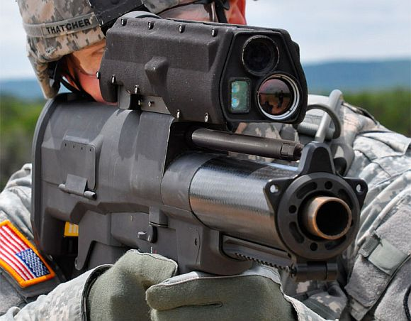 A US soldier with the XM-25 Grenade Launcher