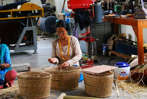An Arunachali women busy making cane baskets