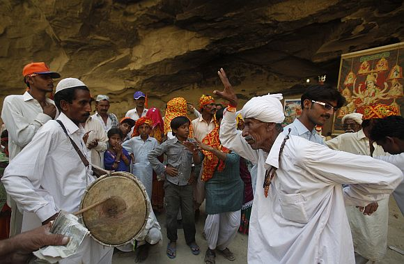 Pakistani Hindu devotees dance to drum beats to praise Shri Hinglaj Mata in Balochistan province