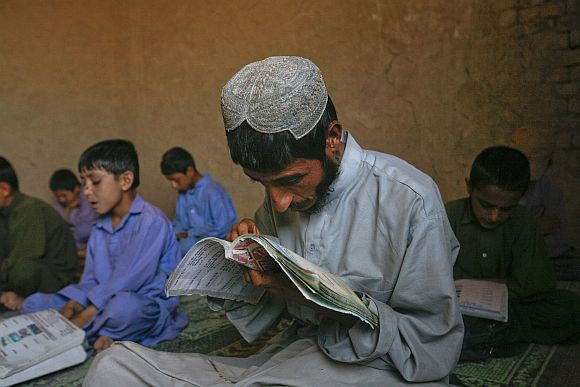 A Pakistani boy learns how to read English at a school on the outskirts of Quetta