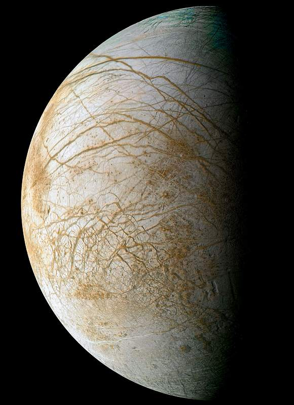 Complex and beautiful patterns adorn the icy surface of Jupiter's moon Europa, as seen in this color image intended to approximate how the satellite might appear to the human eye. Many reddish linear to curvilinear features are observed, some stretching for thousands of kilometers across the surface. The reddish-brown material is a non-ice contaminant that colors Europa's frozen surface.
