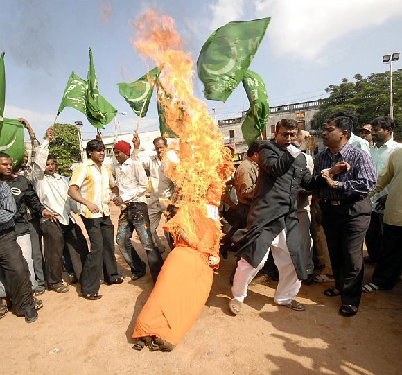 Activists burn the effigy of Sadhvi Pragya Singh Thakur and Lt Col Shrikant Purohit, accused in the Malegaon blasts case in Hyderabad.
