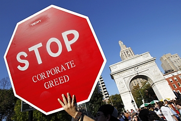 A protester holds a sign during an Occupy Wall Street rally in New York's Washington Square