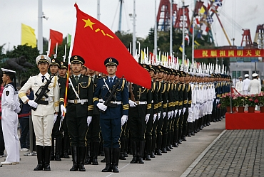 People's Liberation Army soldiers take part in a parade during an open day at a PLA naval base in Hong Kong