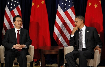 U.S. President Obama listens to Chinese President Hu Jintao during APEC Summit in Hawaii