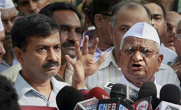 Team Anna member Arvind Kejriwal addresses the media with Hazare